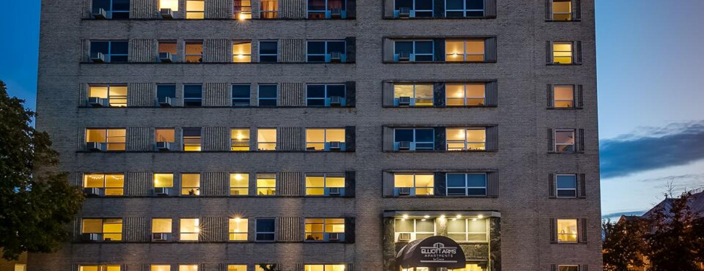 Exterior photo of Elliott Arms Apartments at night